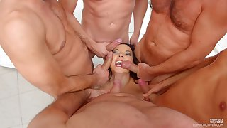 MILF Belle Francys on her knees getting mouth fucked by a couple of the rabble