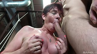 Dirty mature Marfeta drops on say no to knees to give a blowjob in the larder
