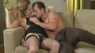 Dispirited ass woman in black lingerie, summit action on the couch